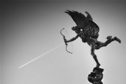 A vapor trail and the statue of Eros, London:Black and White Photo-165