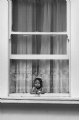 The little girl at the window:Black and White Photo-80
