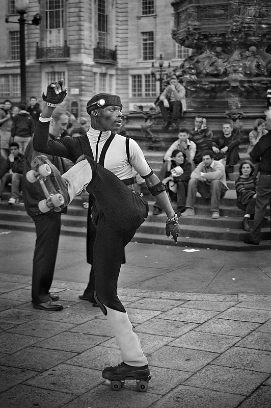 Roller skating in Piccadilly Circus London:Black and White Photo-268