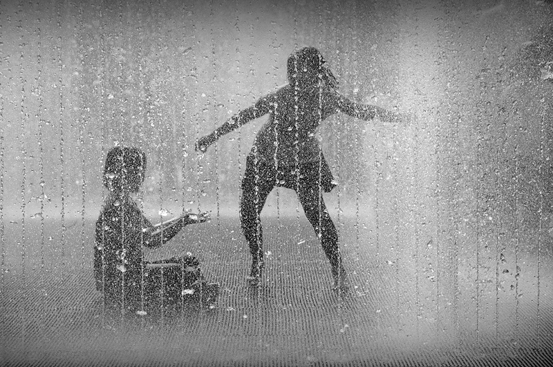 Playing in the fountain:Black and White Photo-326