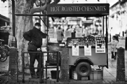 Selling roasted chestnuts:Black and White Photo-477