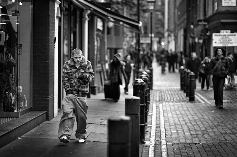 Yang man walking in the street of London:Black and White Photo-377
