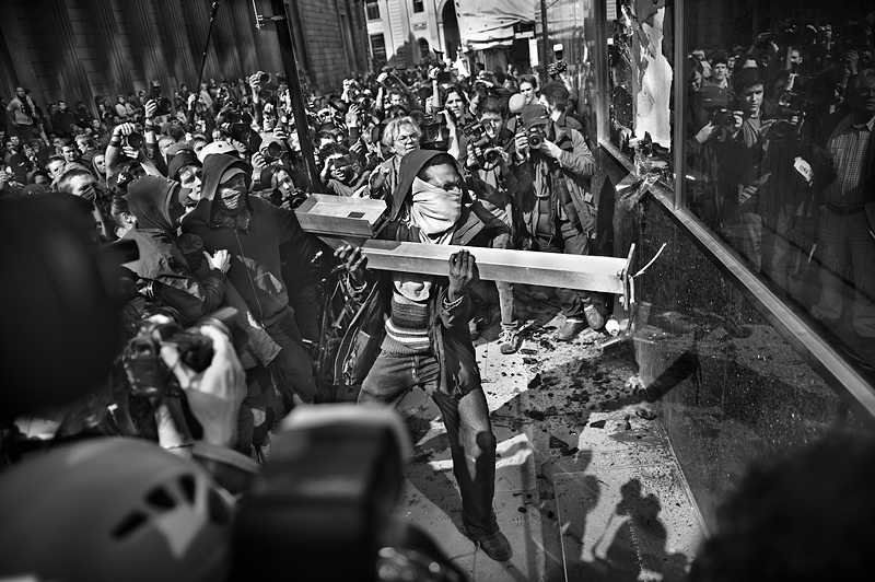 London G20 protester smash the Royal Bank of Scotland windows:Black and White Photo-390