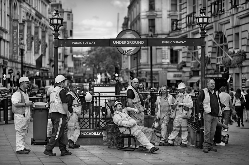 Underground workers on break at Piccadilly Circus, London:Black and White Photo-446