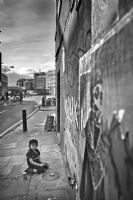 Kid who pays on the pavement, London Brick Lane:Black and White Photo-525