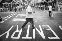 Man crossing the Old Compton Street:Black and White Photo-552